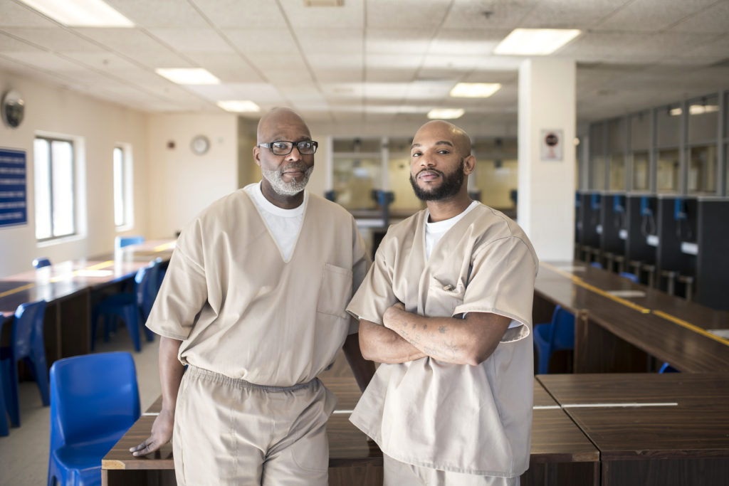 "John Pittman (left) is mentoring Davon Eldemire (right) as part of Connecitcut's TRUE program. Pittman, who is serving 60 years for murder, says: ""Some of us have taken lives, so it's only fair that we try to save lives."" Photograph by Karsten Moran, 2018. CREDIT: Karsten Moran for The Marshall Project"