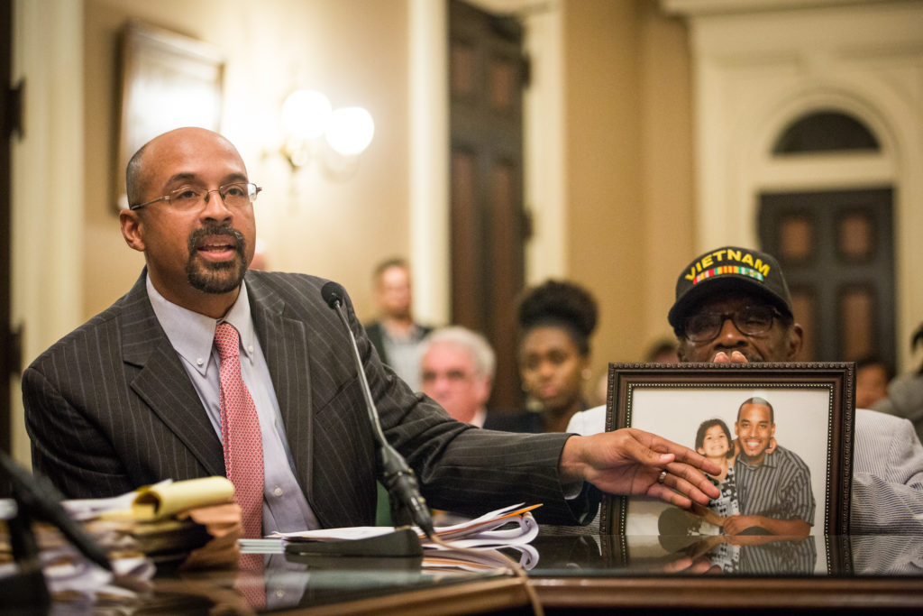 Jacque Wilson (left) testified at the State Capitol about SB 1437 with his father Mack Wilson (right) on behalf of his brother, Neko Wilson, who was awaiting trial under the felony murder rule. Photograph by Max Whittaker/New York Times, 2018.