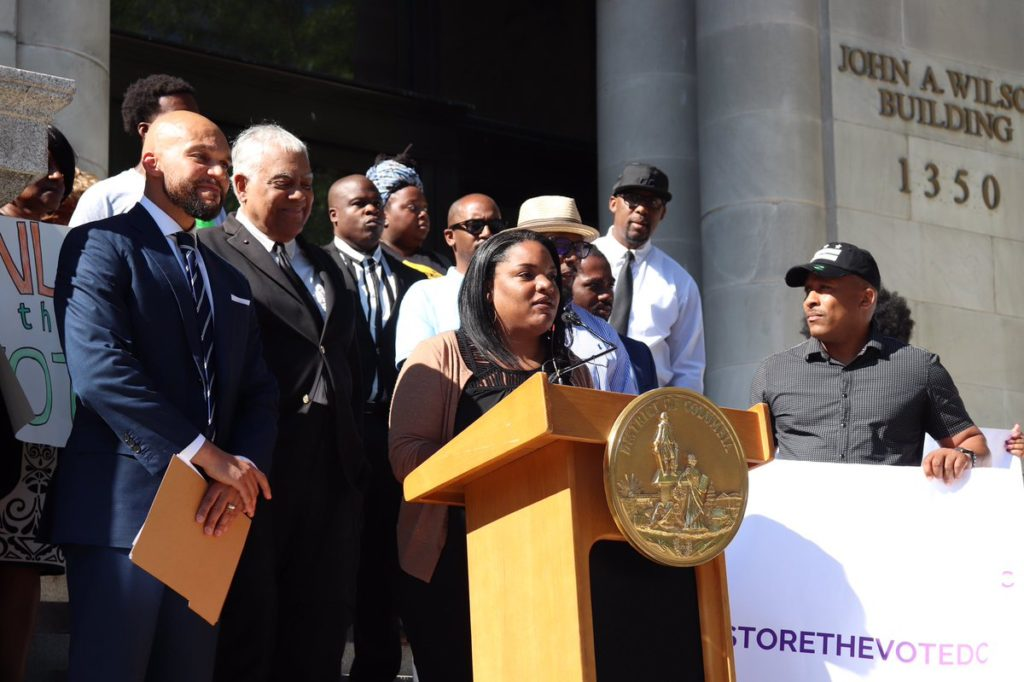 The Sentencing Project's Nicole Porter speaks at a press conference in support of legislation to restore voting rights to imprisoned people in Washington, DC.